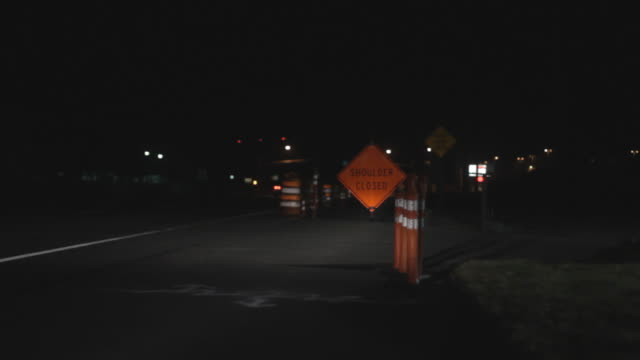 Static shot of Orange shoulder closed sign and traffic cones