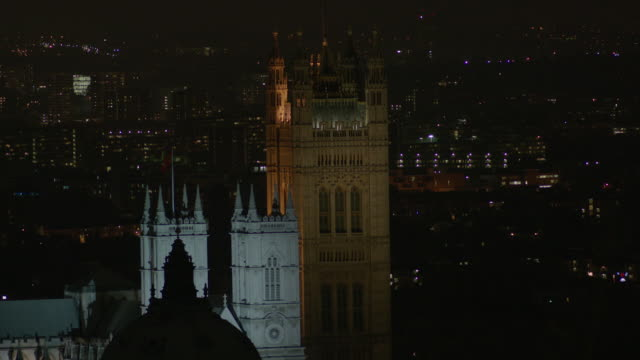 Static shot of part of the Houses of Parliament, Victoria Tower, at night, London, UK.