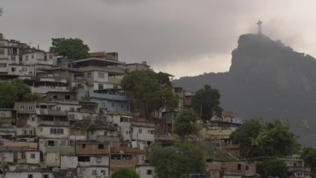 vidéos et rushes de static shot of shanties at the base of corcovado mountain in rio de janeiro, brazil - corcovado