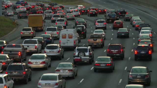 static shot of slowly moving traffic on the freeway in atlanta, georgia. - fanale posteriore video stock e b–roll