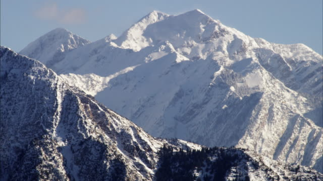 Static shot of snow cover mountains in the Wasatch range, Utah.