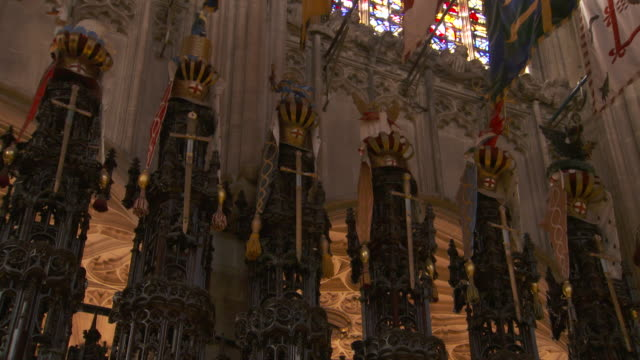 static shot of some of the crests of members of the order of the garter displayed behind the knights' choir stalls of the quire of st george's chapel... - windsor england stock videos and b-roll footage