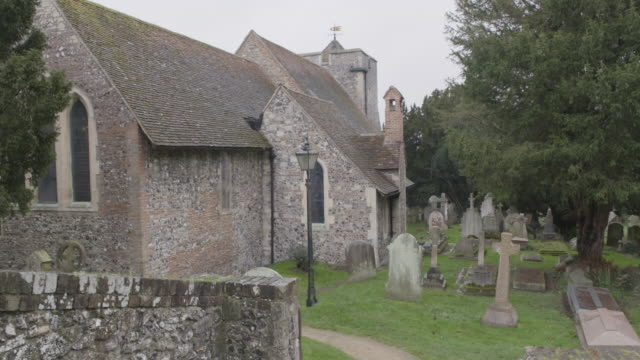 static shot of the churchyard of the st martins church in canterbury - evergreen stock videos & royalty-free footage