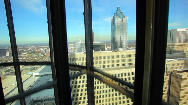 a static shot of the suntrust plaza while going up in a moving elevator. - elevator point of view stock videos and b-roll footage