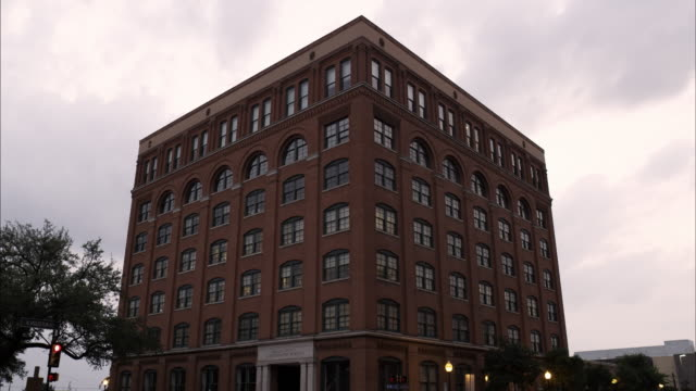 Static shot of the Texas School Book Depository at Dealey Plaza, Dallas.
