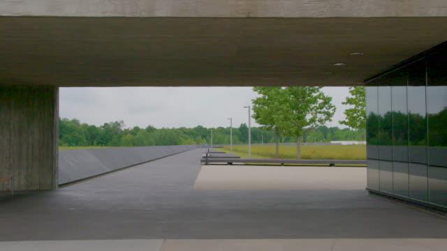 static shot of the visitor center at the flight 93 memorial site - beton stock-videos und b-roll-filmmaterial