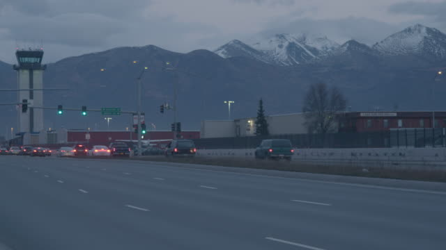 static shot of traffic on anchorage streets at sunset - anchorage alaska stock videos and b-roll footage