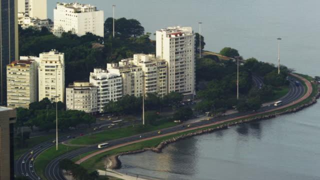 static shot of traffic traveling on avenida das nacoes unidas - avenida stock videos & royalty-free footage