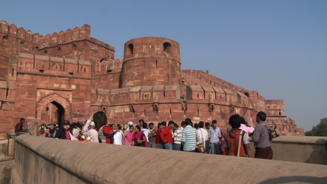 Static shot people approaching the Agra Fort in India.