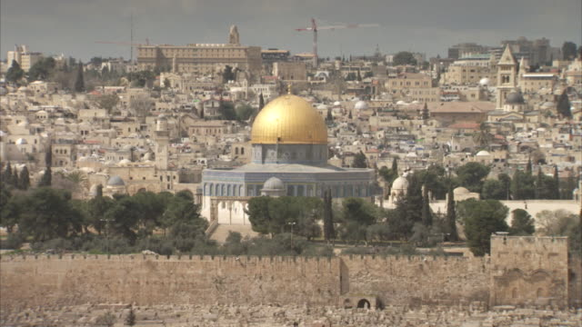 Static shot showing the Dome of the Rock and the Walls of Jerusalem.
