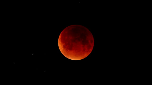 "static shots of the moon during a lunar eclipse - ""bbc universal"" stock videos & royalty-free footage"