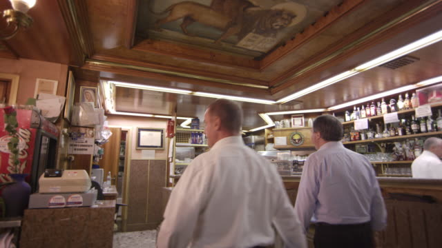 static slow shot of an italian cafe and people moving around. - only mature men stock videos & royalty-free footage