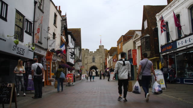 static slow-motion shot of canterbury high street on an overcast day, kent, uk. - high street stock videos & royalty-free footage