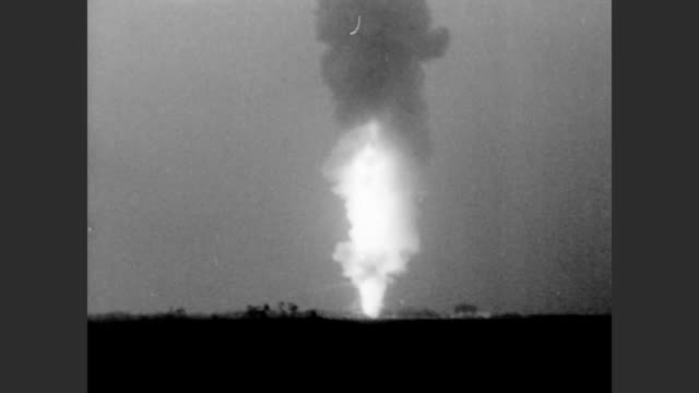 cu static test fire platform with nasa painted on it / inside is a rocket fuel engine / line of flames shoots up into the night sky / shockwave... - miami dade county stock videos and b-roll footage