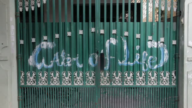 """static tight shot of a green gate at the orphanage """"water of life"""" - orphanage stock videos and b-roll footage"""