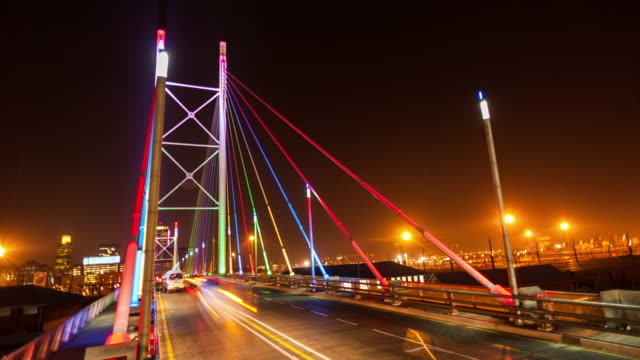 Static timelapse at night shooting down on the Nelson Mandela Bridge in the city centre of Johannesburg, South Africa during peak traffic time