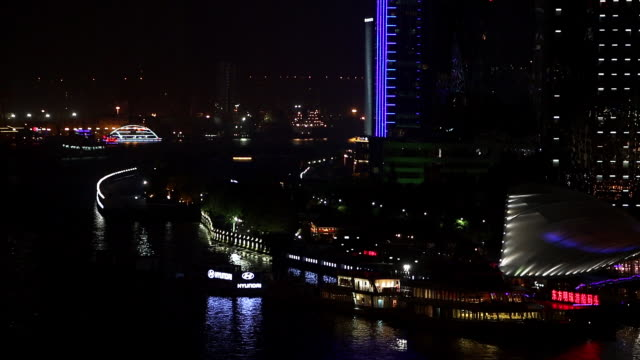 static view of boats and skyscrapers at night near the huangpu river. - river huangpu stock videos & royalty-free footage