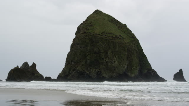 static view of haystack rock on rainy day - haystack rock stock videos & royalty-free footage