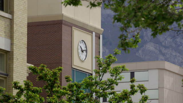 static view of old clock on building in downtown provo, utah - provo stock videos & royalty-free footage