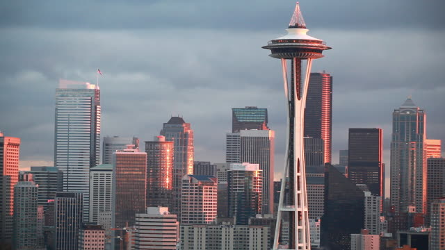 static view of seattle as the sun is setting. - establishing shot stock videos & royalty-free footage