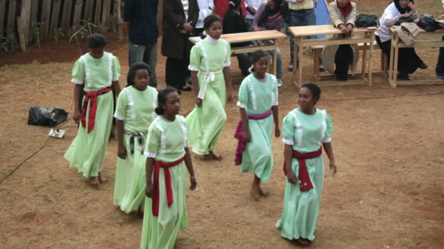 static view of young girls performing for others and dancing. - madagascar stock videos & royalty-free footage