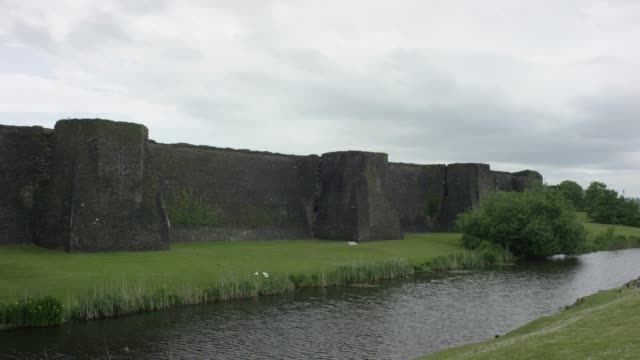 static wide of caerphilly castle - moat stock videos & royalty-free footage
