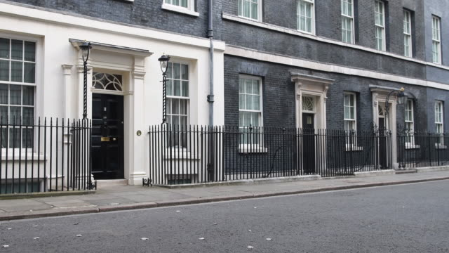 Static wide shot of 11 and 10 Downing Street on October 31 2016 in London England