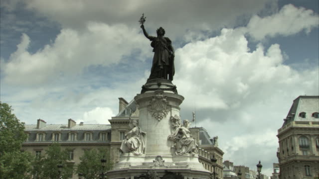 static wide shot showing the bronze statue of marianne in the place de la république in paris, france. - square stock videos and b-roll footage