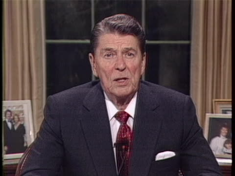 int mcu staticshot zoomin sot president ronald wilson reagan in the oval office at the white house released the statement the evidence is now... - war or terrorism or military stock-videos und b-roll-filmmaterial