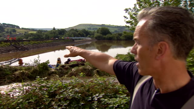 station commander of west yorkshire fire rescue ron taverner pointing out what his team have done to help with the damaged toddbrook reservoir - surface level stock videos & royalty-free footage