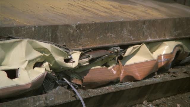 CU SHAKY Station wagon in car crusher