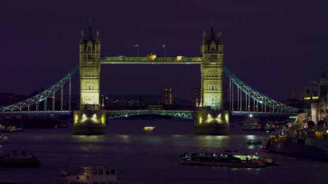 stationary of tower bridge in darkness - tower bridge stock videos & royalty-free footage
