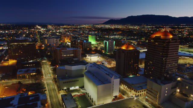 stationary panning drone shot of downtown albuquerque before sunrise - albuquerque new mexico stock videos & royalty-free footage