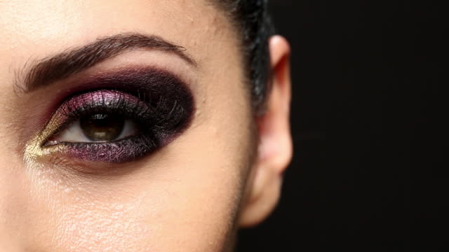 stationary shot of the model applying mascara.   - model stock videos & royalty-free footage
