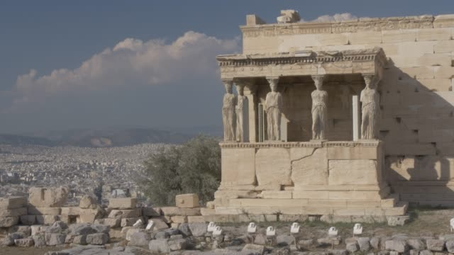 stationary shot showing the erechtheion, the acropolis, unesco world heritage site, athens, greece, europe - antiquities stock videos & royalty-free footage