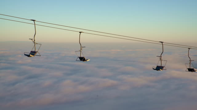 stationary ski lift against the fog - ski lift stock videos & royalty-free footage