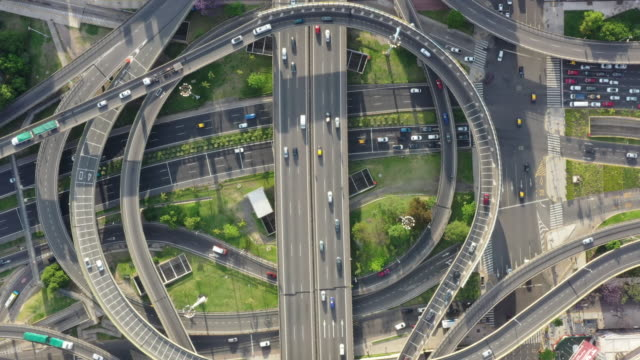 stationary top view, traffic circle highway crossroad and overpasses with traffic - stationary stock videos & royalty-free footage