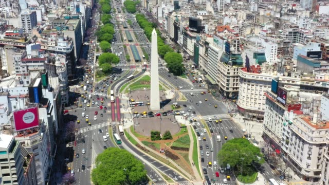 stationary viewpoint. obelisk landmark in buenos aires and green letters ba - avenida 9 de julio stock videos & royalty-free footage