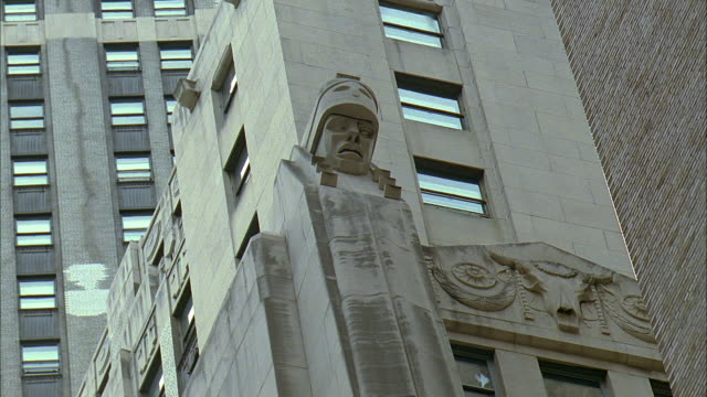 la ms statue and bas relief carving on city bank-farmers trust company building at 20 exchange place / manhattan, new york, new york, usa - bas relief stock videos & royalty-free footage