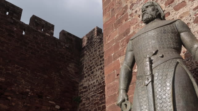 statue at castle door, old town, silves, algarve, portugal, europe - medieval stock videos & royalty-free footage