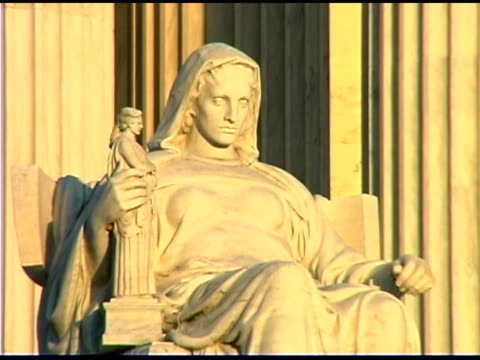 statue at supreme court building, washington dc - us supreme court building stock videos and b-roll footage
