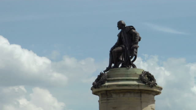 la ms zi statue atop william shakespeare memorial / stratford-upon-avon, england - william shakespeare stock videos and b-roll footage