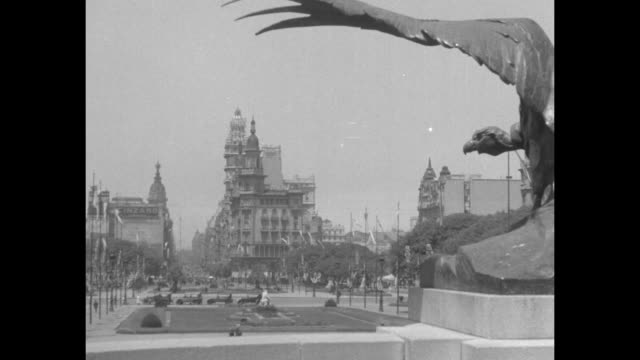 statue depicting a condor rises over a view of a park with the professional community college in the distance / note: exact month/day not known - buenos aires stock videos & royalty-free footage