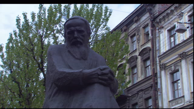 a statue depicts fyodor dostoevsky. - fyodor dostoevsky stock videos & royalty-free footage