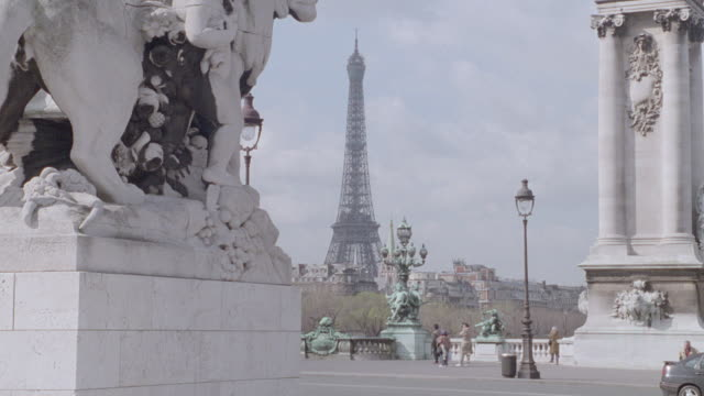 a statue flanks a plaza near the eiffel tower. - 1995 stock videos & royalty-free footage