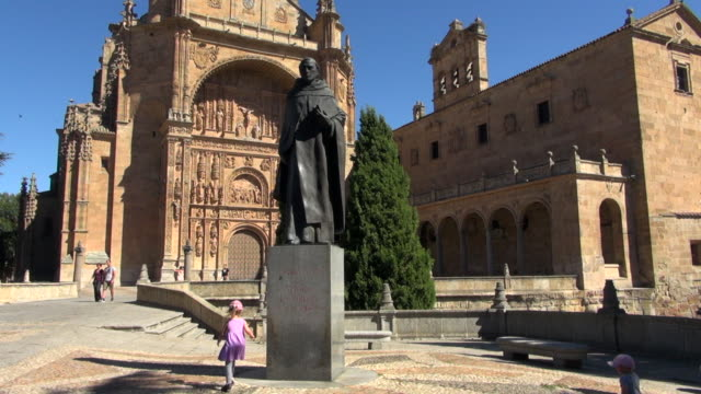 Statue in Front of San Esteban Monastery With Girl