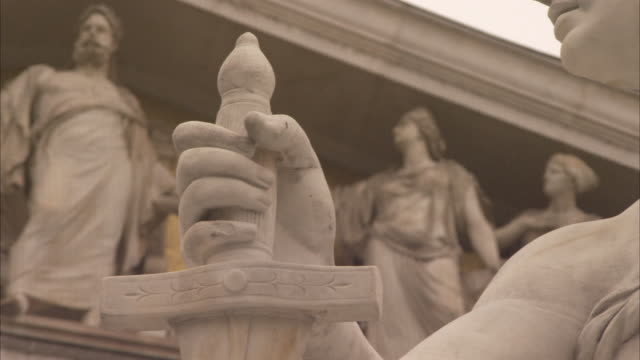 A statue in the Athena Fountain depicts a woman clutching a sword.