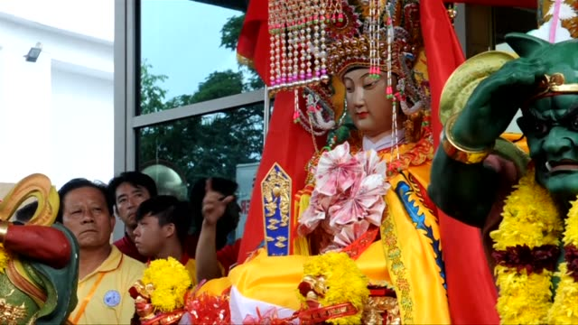 A statue of a Chinese goddess adorned in brightly coloured clothes and an extravagant headdress has become an online sensation after it was pictured...