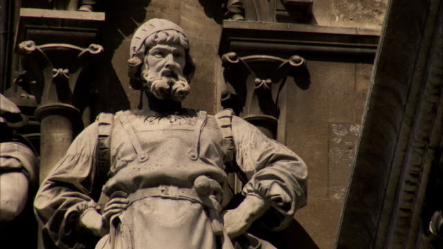A statue of a craftsman features in the facade of the Vienna Rathaus. Available in HD.