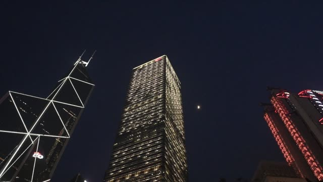 a statue of a lion stands next to the cheung kong center building which houses the headquarters of ck hutchison holdings ltd in hong kong china on... - bank of china tower hong kong stock videos & royalty-free footage